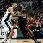 Miami Heat forward LeBron James, right, drives against San Antonio forward Tim Duncan during the second quarter of Game 5 in the NBA Finals basketball series in San Antonio on Sunday, June 1 …