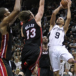 San Antonio guard Tony Parker goes to the basket against Miami Heat forward Chris Bosh,left, forward Mike Miller,,center and guard Dwyane Wade, right during the fourth quarter of Game 5 in t …