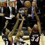 Miami Heat's Udonis Haslem (40) San Antonio Spurs' Tim Duncan (21) and Ray Allen (34) go after a loose ball during the first half at Game 5 of the NBA Finals basketball series, Sunday, June  …