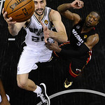 San Antonio Spurs' Manu Ginobili (20), of Argentina, shoots as Miami Heat's Dwyane Wade defends during the second half at Game 5 of the NBA Finals basketball series, Sunday, June 16, 2013, i …