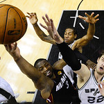Miami Heat's Dwyane Wade (3) shoots as San Antonio Spurs' Kawhi Leonard, rear, and Tiago Splitter (22) defend during the first half at Game 5 of the NBA Finals basketball series, Sunday, Jun …