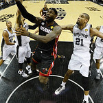 Miami Heat's LeBron James (6) shoots as San Antonio Spurs' Tim Duncan (21) defends during the first half at Game 5 of the NBA Finals basketball series, Sunday, June 16, 2013, in San Antonio. …