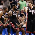 Miami Heat's Dwyane Wade, LeBron James, Mike Miller (13) from left, talk on the sideline against the San Antonio Spurs during the second half at Game 5 of the NBA Finals basketball series, S …