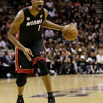 Miami Heat center Chris Bosh (1) moves the ball against the San Antonio Spurs during the second half at Game 5 of the NBA Finals basketball series, Sunday, June 16, 2013, in San Antonio. The …
