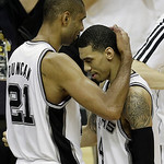 San Antonio Spurs' Tim Duncan (21) embraces Danny Green during the second half at Game 5 of the NBA Finals basketball series, against the Miami Heat, Sunday, June 16, 2013, in San Antonio. ( …