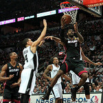 Miami Heat forward LeBron James (6) goes to the basket against San Antonio guard Danny Green, left and teammates forward  Kawhi Leonard, center, forward Tim Duncan, right during the second q …