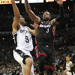 San Antonio guard Tony Parker, left, of France, goes to the basket against Miami Heat guard Dwyane Wade during the fourth quarter of Game 5 in the NBA Finals in San Antonio on Sunday, June 1 …