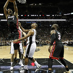 Miami Heat's Chris Bosh (1) loses the ball as San Antonio Spurs' Gary Neal (14) defends during the first half at Game 5 of the NBA Finals basketball series, Sunday, June 16, 2013, in San Ant …