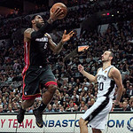 Miami Heat forward LeBron James goes to the basket against San Antonio guard Manu Ginobili, of Argentina, during the second quarter of Game 5 in the NBA Finals basketball series, Sunday, Jun …