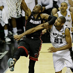 Miami Heat's Dwyane Wade (3) shoots as San Antonio Spurs' Tim Duncan (21) defends during the second half at Game 5 of the NBA Finals basketball series, Sunday, June 16, 2013, in San Antonio. …