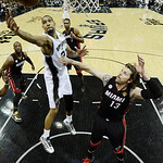 San Antonio Spurs' Tim Duncan (21) grabs a rebound as Miami Heat's Mike Miller (13) defends during the second half at Game 5 of the NBA Finals basketball series, Sunday, June 16, 2013, in Sa …