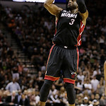 Miami Heat shooting guard Dwyane Wade (3) shoots against the San Antonio Spurs during the second half at Game 5 of the NBA Finals basketball series, Sunday, June 16, 2013, in San Antonio. (A …