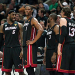 Miami Heat forward LeBron James, left, talks with teammates forward Chris Bosh (1), guard Dwyane Wade and forward Mike Miller (13) during the second quarter of Game 5 in the NBA Finals bask …