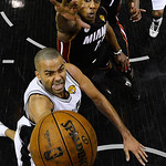 San Antonio Spurs' Tony Parker shoots as Miami Heat's Mario Chalmers defends during the second half at Game 5 of the NBA Finals basketball series, Sunday, June 16, 2013, in San Antonio. The  …
