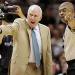 San Antonio Spurs' Gregg Popovich and referee Tony Brothers (25) discuss action during the first half at Game 5 of the NBA Finals basketball series against the Miami Heat, Sunday, June 16, 2 …