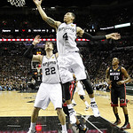 San Antonio Spurs' Danny Green (4) goes after a rebound against the Miami Heat during the first half at Game 5 of the NBA Finals basketball series, Sunday, June 16, 2013, in San Antonio. (AP …