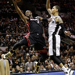 Miami Heat's Dwyane Wade (3) shoots against San Antonio Spurs' Danny Green (4) during the second half at Game 5 of the NBA Finals basketball series, Sunday, June 16, 2013, in San Antonio. (A …