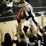 San Antonio Spurs' Danny Green reacts after scoring a three-point basket against the Miami Heat during the second half at Game 5 of the NBA Finals basketball series, Sunday, June 16, 2013, i …