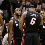 Miami Heat players Chris Bosh (1), Dwyane Wade (3), LeBron James (6), Mario Chalmers, and Ray Allen (34) pause at a break against the San Antonio Spurs during the second half at Game 5 of th …