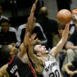 San Antonio Spurs' Manu Ginobili (20), of Argentina, attempts a shot as Miami Heat's Chris Bosh (1) defends during the second half at Game 5 of the NBA Finals basketball series, Sunday, June …