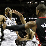 Miami Heat's Dwyane Wade (3) passes around San Antonio Spurs' Tim Duncan during the first half at Game 5 of the NBA Finals basketball series, Sunday, June 16, 2013, in San Antonio. (AP Photo …