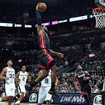 Miami Heat forward LeBron James, center, dunks against San Antonio forward Boris Diaw (33), forward Kawhi Leonard and guard Tony Parker (9), of France, during the second quarter of Game 5 in …