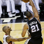 San Antonio Spurs power forward Tim Duncan (21) dunks on the Miami Heat during the first half of Game 6 of the NBA Finals basketball game, Tuesday, June 18, 2013 in Miami. (AP Photo/Wilfredo …