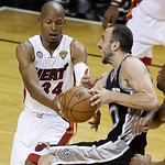 Miami Heat shooting guard Ray Allen (34) defends San Antonio Spurs shooting guard Manu Ginobili (20) of Argentina during overtime of Game 6 of the NBA Finals basketball game, Wednesday, June …