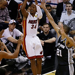 Miami Heat shooting guard Ray Allen (34) drives to the basket as San Antonio Spurs power forward Tim Duncan (21) defends during the first half of Game 6 of the NBA Finals basketball game, Tu …