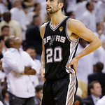 San Antonio Spurs shooting guard Manu Ginobili (20) walks on the court during overtime of Game 6 of the NBA Finals basketball game against the Miami Heat, Wednesday, June 19, 2013 in Miami.  …