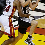 San Antonio Spurs shooting guard Manu Ginobili (20) of Argentina drives to the basket as Miami Heat shooting guard Ray Allen (34) defends during overtime of Game 6 of the NBA Finals basketba …