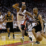 San Antonio Spurs guard Tony Parker (9) drives the ball as Miami Heat center Chris Bosh (1) defends during overtime of Game 6 of the NBA Finals basketball game, Wednesday, June 19, 2013 in M …