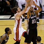Miami Heat shooting guard Mike Miller (13) drives to the basket against San Antonio Spurs power forward Tim Duncan (21) during the second half of Game 6 of the NBA Finals basketball game, Tu …