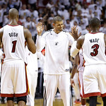 Miami Heat small forward Shane Battier (31) shakes hands with Miami Heat center Chris Bosh (1) and guard Dwyane Wade (3) during overtime of Game 6 of the NBA Finals basketball game, Wednesda …