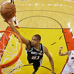 San Antonio Spurs power forward Tim Duncan (21) shoots against Miami Heat shooting guard Mike Miller (13) during the second half of Game 6 in the NBA Finals basketball series,  Wednesday, Ju …