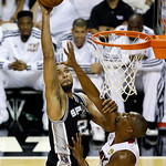San Antonio Spurs forward Tim Duncan (21) shoots against Miami Heat center Chris Bosh (1) during the first half of Game 6 in their NBA Finals basketball series, Tuesday, June 18, 2013 in Mia …