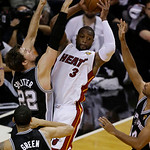 Miami Heat shooting guard Dwyane Wade (3) looks to pass under pressure from San Antonio Spurs center Tiago Splitter (22) of Brazil during the first half of Game 6 of the NBA Finals basketbal …