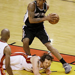 San Antonio Spurs small forward Kawhi Leonard (2) moves the ball over Miami Heat shooting guard Mike Miller (13) during the second half of Game 6 of the NBA Finals basketball game, Tuesday,  …