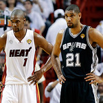 Miami Heat center Chris Bosh (1) and San Antonio Spurs forward Tim Duncan (21) stand on the court during the first half of Game 6  in their NBA Finals basketball series, Tuesday, June 18, 20 …