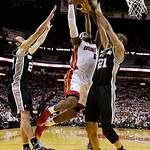 Miami Heat forward LeBron James (6) drives to the basket as San Antonio Spurs power forward Tim Duncan (21) and guard Manu Ginobili (20) of Argentina defend during the first half of Game 6 o …