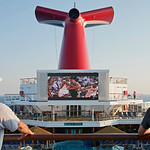 In this photo provided by Carnival Cruise Lines, passengers aboard the Carnival Sunshine watch the final minute of overtime live during Game 6 of the Miami Heat and San Antonio Spurs NBA Fin …