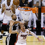 San Antonio Spurs power forward Tim Duncan (21) blocks the shot of Miami Heat shooting guard Mike Miller (13) during the second half of Game 6 of the NBA Finals basketball game, Tuesday, Jun …