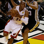 Miami Heat shooting guard Ray Allen (34) drives to the basket as San Antonio Spurs center Boris Diaw (33) of France defends during the first half of Game 6 of the NBA Finals basketball game, …