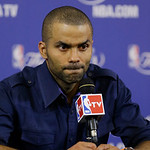 San Antonio Spurs guard Tony Parker (9) listens to a question during the post-game news conference following Game 6 of the NBA Finals basketball game, Wednesday, June 19, 2013 in Miami. The  …