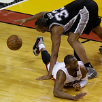 Miami Heat shooting guard Dwyane Wade (3) looses the ball as San Antonio Spurs center Boris Diaw (33) of France attempts to control during the second half of Game 6 of the NBA Finals basketb …