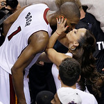Miami Heat center Chris Bosh (1) kisses his wife  Adrienne at the end of overtime of Game 6 of the NBA Finals basketball game against the San Antonio Spurs, Wednesday, June 19, 2013 in Miami …