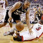 San Antonio Spurs center Boris Diaw (33) of France grabs a ball dropped by Miami Heat shooting guard Dwyane Wade (3) during the second half of Game 6 in the NBA Finals basketball game, Tuesd …