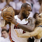 San Antonio Spurs guard Tony Parker (9) and Miami Heat forward LeBron James (6) collide during the second half of Game 6 of their NBA Finals basketball series, Tuesday, June 18, 2013 in Miam …