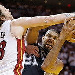 San Antonio Spurs power forward Tim Duncan (21) works as Miami Heat shooting guard Mike Miller (13) defends during the second half of Game 6 of the NBA Finals basketball game, Tuesday, June  …