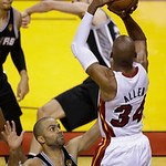 Miami Heat  guard Ray Allen (34) aims a three point shot as San Antonio Spurs guard Tony Parker (9) defends during Game 6 of the NBA Finals basketball game, Wednesday, June 19, 2013 in Miami …